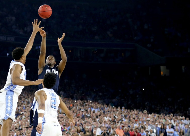 Kris Jenkins #2 of the Villanova Wildcats shoots the game-winning three pointer to defeat the North Carolina Tar Heels 77-74 in the 2016 NCAA Men's Final Four National Championship game at NRG Stadium on April 4, 2016 in Houston, Texas. (Photo by Streeter Lecka/Getty Images)