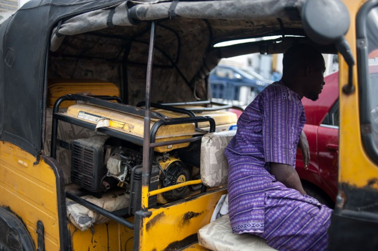 A Tuk tuk loaded wit generators waits in line at a fuel station in Lagos on April 6, 2016. Fuel dependant Nigeria has been in the grip of fuel scarcity for the last couple of weeks affecting peoples ability to generate electricity. Due to the fuel scarcity, there has been an increase in the price of goods, commodities and transport fares as well as an increased activity of black market fuel hawkers that sell diluted fuel at extortionate prices. (AFP Photo/Stefan Heunis)