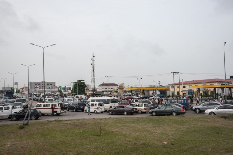 Roads in Lagos are blocked as people queue outside filling stations to buy fuel on April 6, 2016. Fuel dependant Nigeria has been in the grip of fuel scarcity for the last couple of weeks affecting peoples ability to generate electricity. Due to the fuel scarcity, there has been an increase in the price of goods, commodities and transport fares as well as an increased activity of black market fuel hawkers that sell diluted fuel at extortionate prices. (AFP Photo/Stefan Heunis)