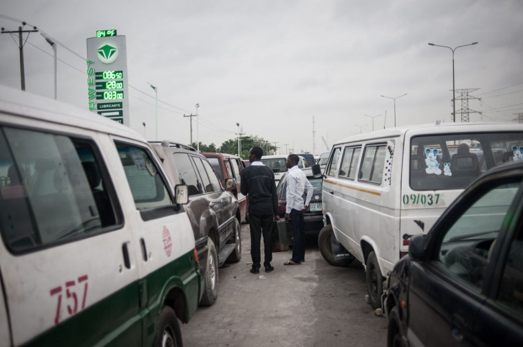 People wait in a queue outside of a filing stationing in Lagos on April 6, 2016. Fuel dependant Nigeria has been in the grip of fuel scarcity for the last couple of weeks affecting peoples ability to generate electricity. Due to the fuel scarcity, there has been an increase in the price of goods, commodities and transport fares as well as an increased activity of black market fuel hawkers that sell diluted fuel at extortionate prices. (AFP Photo/Stefan Heunis)