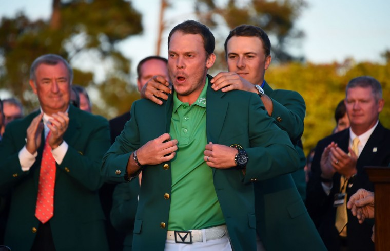US golfer Jordan Spieth presents the Green Jacket to England's Danny Willett at the end of the 80th Masters Golf Tournament at the Augusta National Golf Club on April 10, 2016, in Augusta, Georgia. England's Danny Willett won the 80th Masters at Augusta National for his first major title. He was trailing defending champion Jordan Spieth by five strokes around the turn, but stormed down the back nine to overhaul the American. Willett is the first Englishman since Nick Faldo 20 years ago to win the Masters and only the second all-time. (Jim Watson/AFP/Getty Images)