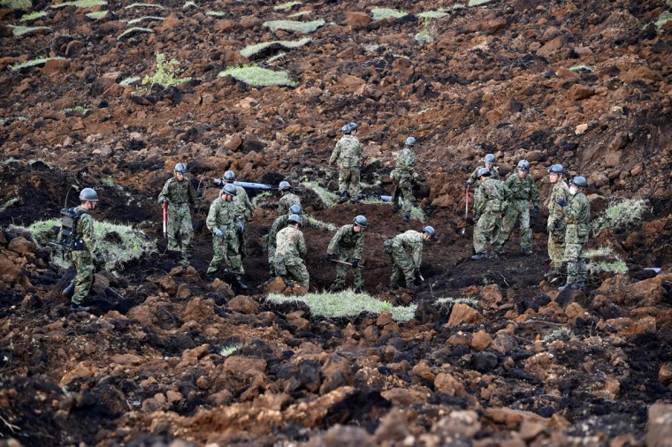 Troops from Japan's Ground Self-Defense Force search for survivors at a landslide site after earthquakes in Minami-Aso, Kumamoto prefecture, on April 17, 2016. At least 41 people are known to have died in the double disaster, with up to eight still missing -- feared buried in shattered houses or under torrents of mud. / AFP PHOTO / KAZUHIRO NOGIKAZUHIRO NOGI/AFP/Getty Images