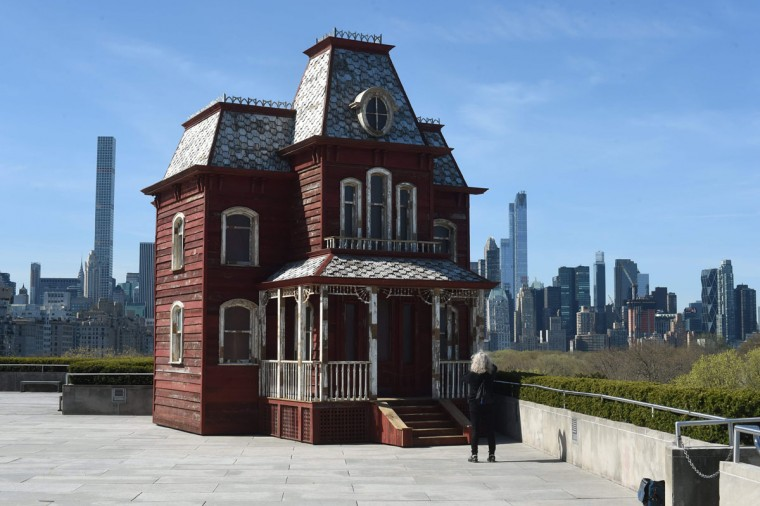 """A large-scale sculpture by British artist Cornelia Parker, inspired by the paintings of Edward Hopper and by two emblems of American architecturethe classic red barn, and the Bates family's mansion from Alfred Hitchcock's 1960 film """"Psycho"""". The show comprises the fourth annual installation of site-specific works commissioned for The Metropolitan Museum of Art's Iris and B. Gerald Cantor Roof Garden. AFP PHOTO / TIMOTHY A. CLARY"""