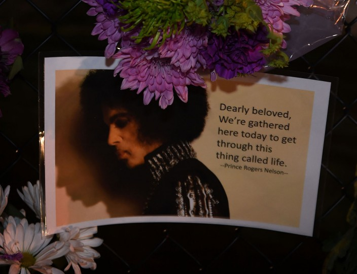 Messages left by fans outside the Paisley Park residential compound of music legend Prince in Minneapolis, Minnesota, on April 21, 2016. Emergency personnel tried and failed to revive music legend Prince, who died April 21, 2016, at age 57, after finding him slumped unresponsive in an elevator at his Paisley Park studios in Minnesota, the local sheriff said. (Mark Ralston/AFP/Getty Images)