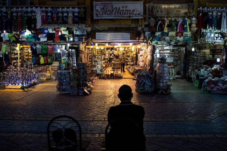 A shop owner waits for customers in the Old Market district on April 3, 2016 in Sharm El Sheikh, Egypt. Prior to the Arab Spring in 2011 some 15million tourists would visit Egypt each year. The resort town of Sharm El Sheikh was built around tourism however tourist numbers have plummeted after recent terrorist attacks with flights from major UK carriers being suspended and foreign offices around the world warning citizens of the 'High threat from terrorism' Sharm El Sheikh is almost a ghost town, with many resorts being abandoned and business forced to close. (Photo by Chris McGrath/Getty Images)