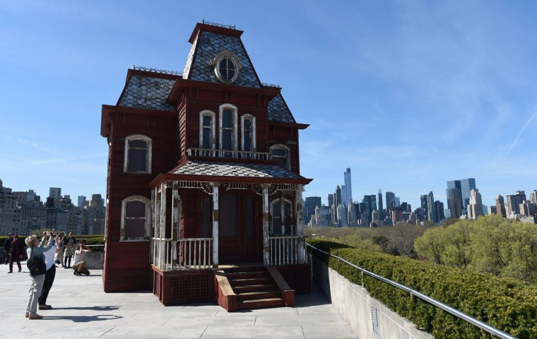 "A large-scale sculpture by British artist Cornelia Parker, inspired by the paintings of Edward Hopper and by two emblems of American architecturethe classic red barn, and the Bates family's mansion from Alfred Hitchcock's 1960 film ""Psycho"". The show comprises the fourth annual installation of site-specific works commissioned for The Metropolitan Museum of Art's Iris and B. Gerald Cantor Roof Garden. AFP PHOTO / TIMOTHY A. CLARY"