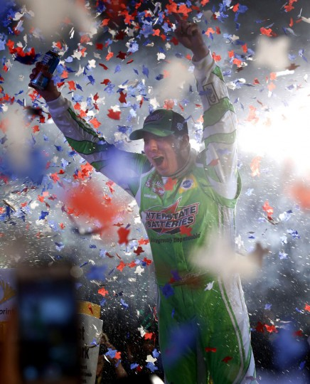 Kyle Busch celebrates after winning the NASCAR Sprint Cup Series auto race at Texas Motor Speedway in Fort Worth, Texas, early Sunday, April 10, 2016. (AP Photo/Ralph Lauer)