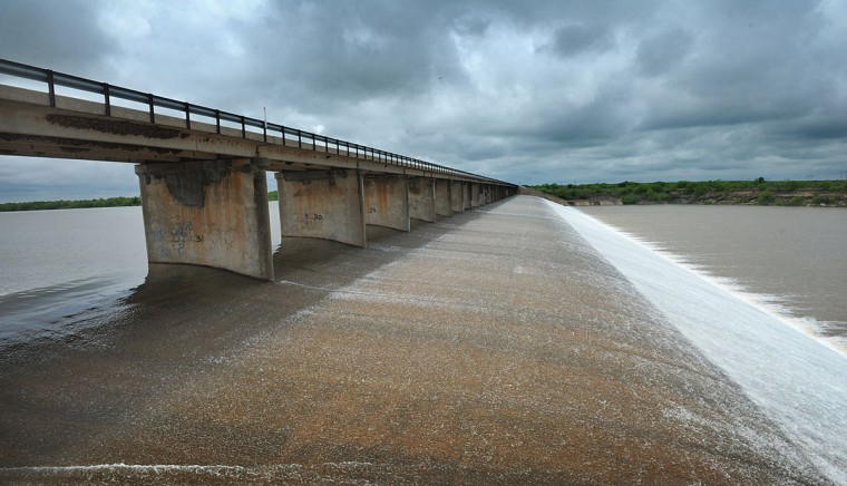 Heavy rainfall in the North Texas area over the weekend has again brought Lake Arrowhead, near Wichita Falls, Texas, to capacity and water over the spillway. (Torin Halsey/Times Record News via AP)