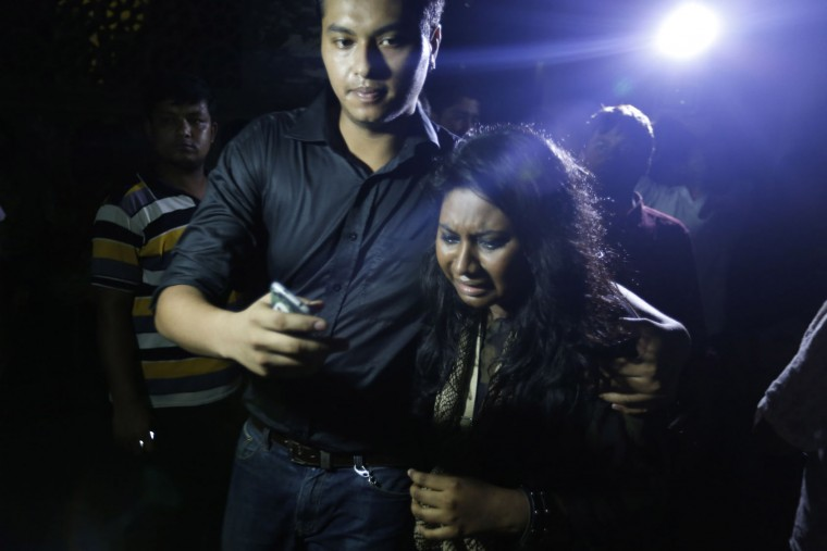 An unidentified co worker of U.S. Agency for International Development, (USAID) employee Xulhaz Mannan who was stabbed to death wails as she returns from the crime spot in Dhaka, Bangladesh, Monday, April 25, 2016. Unidentified assailants fatally stabbed two men in Bangladesh's capital Monday night, including a gay rights activist who also worked for the USAID police said, in the latest in a series of attacks targeting atheists, moderates and foreigners. (AP Photo)