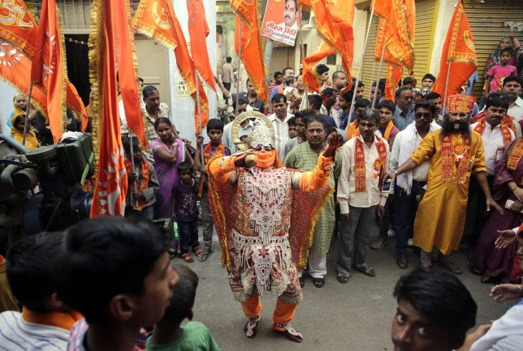 An Indian devotee dressed as the Hindu Lord Hanuman participates in a procession to celebrate the Ram Navami festival in Allahabad, India, Friday, April 15, 2016. Hindu devotees celebrate the festival of Ram Navami, the birth anniversary of Lord Rama, which also marks the end of the nine-day long fasting and Navaratri festival. (AP Photo/Rajesh Kumar Singh)