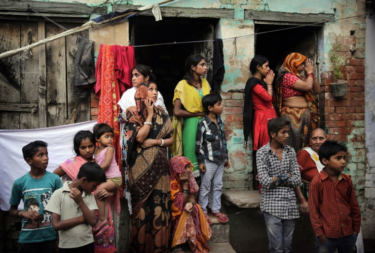 Indians watch a procession of Ram Navami festival in Allahabad, India, Friday, April 15, 2016. Hindu devotees celebrate the festival of Ram Navami, the birth anniversary of Lord Rama, which also marks the end of the nine-day long fasting and Navaratri festival. (AP Photo/Rajesh Kumar Singh)
