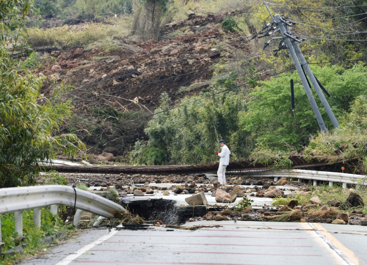 A rail track is swept away by a landslide caused by an earthquake in Minamiaso, Kumamoto prefecture, southern Japan Saturday, April 16, 2016. Powerful earthquakes a day apart shook southwestern Japan, as thousands of army troops and other rescuers on Saturday rushed to save scores of trapped residents before weather turns bad. (Kyodo News via AP)