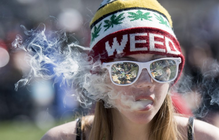 A woman exhales while smoking marijuana during the annual 420 marijuana rally on Parliament Hill in Ottawa, Canada, Wednesday, April 20, 2016. Cannabis possession is illegal in most countries under a 1925 treaty called the International Opium Convention. But just like the U.S., some nations either flout the treaty or don't enforce it. Legalization supporters consider pot possession either legal or tolerated in Argentina, Bangladesh, Cambodia, Canada, Chile, Colombia, the Czech Republic, India, Jamaica, Jordan, Mexico, Portugal, Spain, Uruguay, Germany and the Netherlands. (Justin Tang/The Canadian Press via AP)