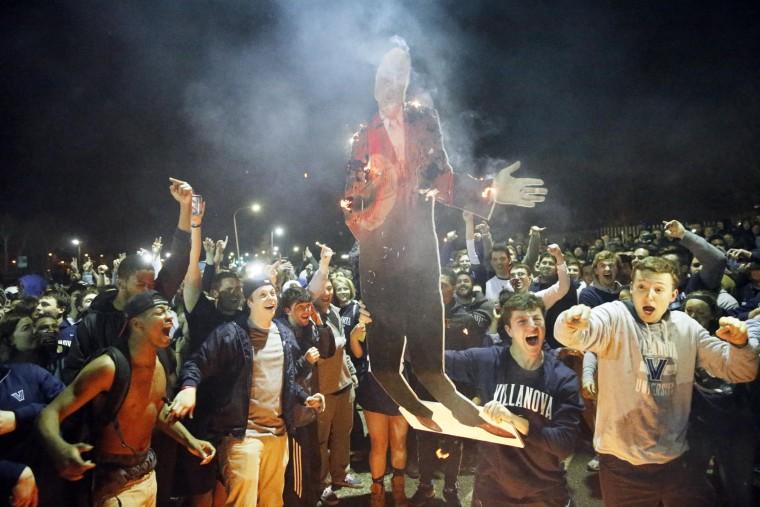 Villanova basketball fans celebrate after Villanova defeated North Carolina in the NCAA tournament college basketball championship game, Tuesday, April 5, 2016, in Villanova, Pa. Villanova won 77-74. (AP Photo/Matt Rourke)