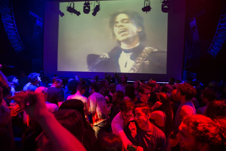 """A crowd pays tribute to Prince inside First Ave where """"Purple Rain"""" was filmed late Thursday, April 21, 2016 in Minneapolis. Prince, widely acclaimed as one of the most inventive and influential musicians of his era with hits including """"Little Red Corvette,"""" ''Let's Go Crazy"""" and """"When Doves Cry,"""" was found dead at his home on Thursday in suburban Minneapolis, according to his publicist. He was 57. (Renee Jones Schneider/Star Tribune via AP)"""