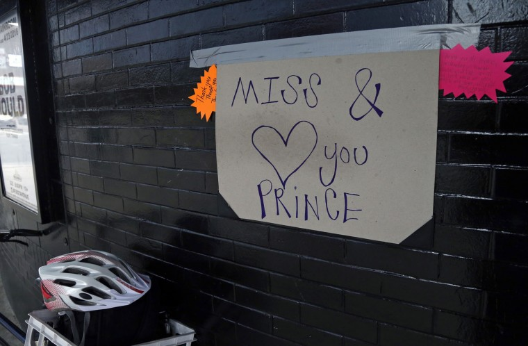 A home made sign is attached to the wall in memory of Prince at First Avenue Friday, April 22, 2016, in Minneapolis where he often performed. The pop super star died Thursday at the age of 57. (AP Photo/Jim Mone)