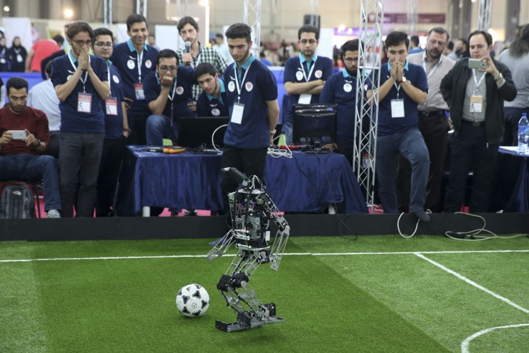 A humanoid robot of Iranian students from Amir Kabir university plays in a soccer match during the international robotics competition, RoboCup Iran Open 2016, in Tehran, Iran, Wednesday, April 6, 2016. The event, organized by Iranian RoboCup Regional Committee and Qazvin Azad University, was participated by 320 teams from Iran and abroad. The 3-day competitions kicked off on Wednesday at Tehran's Permanent Fairground. (AP Photo/Vahid Salemi)