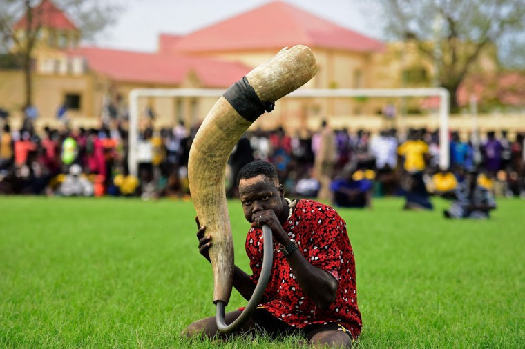 A supporter blows a traditional horn during the South Sudan National Wrestling Competition for peace at Juba Stadium, on April 20, 2016. South Sudan is holding a wrestling for peace tournament, bringing together athletes from around the country. The last big tournament was canceled when civil war broke out in December 2013. (CARL DE SOUZA/AFP/Getty Images)