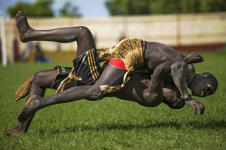 Two participants from Imatong and Terekeka counties take part of the South Sudan National Wrestling Competition for peace at Juba Stadium, on April 20, 2016. (ALBERT GONZALEZ FARRAN/AFP/Getty Images)