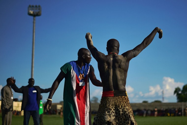 A wrestler from Eastern Lakes State gets ready for the semifinal of the South Sudan National Wrestling Competition for peace at Juba Stadium, South Sudan, on April 21, 2016. (CARL DE SOUZA/AFP/Getty Images)