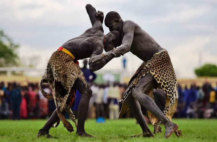 Wrestlers from Jonglei and eastern lakes region take part in the South Sudan National Wrestling Competition for peace at Juba Stadium, South Sudan, on April 20, 2016. (CARL DE SOUZA/AFP/Getty Images)