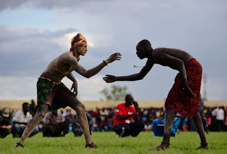 Wrestlers from Jonglei and the Eastern Lakes states take part in the South Sudan National Wrestling Competition for peace at Juba Stadium, South Sudan, on April 20, 2016. (CARL DE SOUZA/AFP/Getty Images)