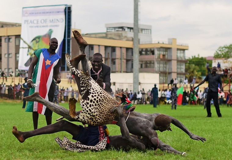 Wrestlers from Jonglei and the Eastern Lakes states take part in the South Sudan National Wrestling Competition for peace at Juba Stadium, on April 20, 2016. (CARL DE SOUZA/AFP/Getty Images)