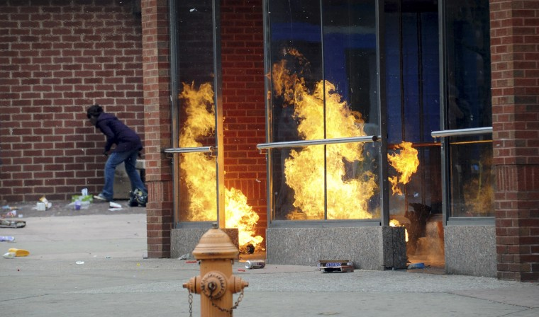 Part of the Penn-North Baltimore Metro Station burns after being set afire April 27, 2015, as unrest roiled through several Baltimore neighborhoods on the day of Freddie Gray's funeral. Looting and fires spotted the area around North and Pennsylvania avenues, consuming a CVS Pharmacy next to the station. (Algerina Perna/Baltimore Sun)
