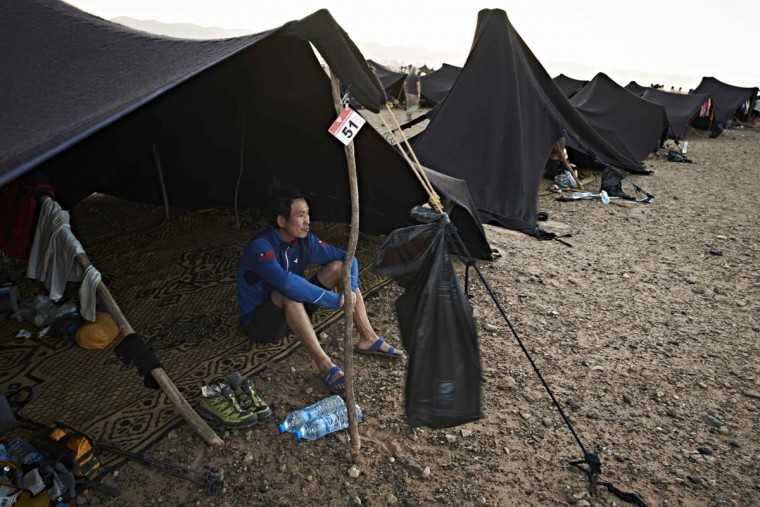 Competitors rest at their bivouac during the 31st edition of the Marathon des Sables between Oued Moungarf and Ba Hallou in the southern Moroccan Sahara desert on April 12, 2016. (JEAN-PHILIPPE KSIAZEK/AFP/Getty Images)