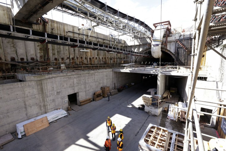 A portion of the upper deck of the new State Route 99 under construction rests just in front of the circular entrance to the tunnel Monday, April 25, 2016, in Seattle. The Alaskan Way viaduct, which the two-mile tunnel will replace, is scheduled to be closed for about two weeks beginning Friday, April 29, as a precaution as tunnel boring begins under the structure. The tunneling machine is boring a double-decker traffic tunnel to replace the viaduct damaged in an earthquake in 2001. (AP Photo/Elaine Thompson)