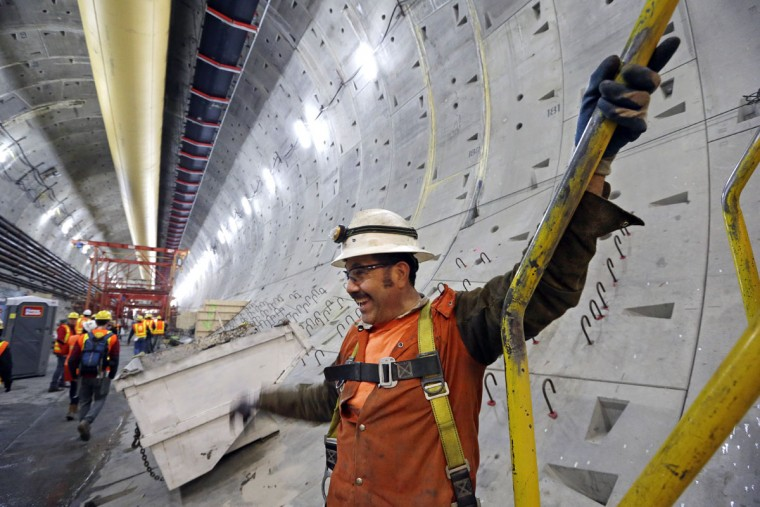 Construction worker Antonio Roman smiles as he stands inside the State Route 99 tunnel that is under construction Monday, April 25, 2016, in Seattle. The Alaskan Way viaduct, which the two-mile tunnel will replace, is scheduled to be closed for about two weeks beginning Friday, April 29, as a precaution as tunnel boring begins under the structure. The tunneling machine is boring a double-decker traffic tunnel to replace the viaduct damaged in an earthquake in 2001. (AP Photo/Elaine Thompson)