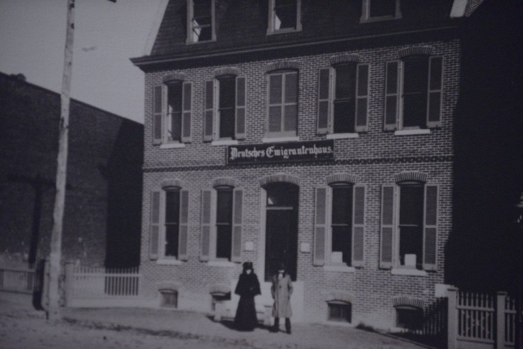 An archival photo at the Immigration Museum shows the exterior of the German Immigrant House in the early 1900s.