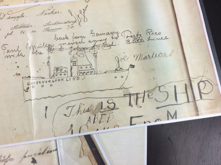 Copies of the guestbook at the German Immigrant House show a child's illustration of the boat that transported him from Europe to America. (Christina Tkacik/Baltimore Sun)