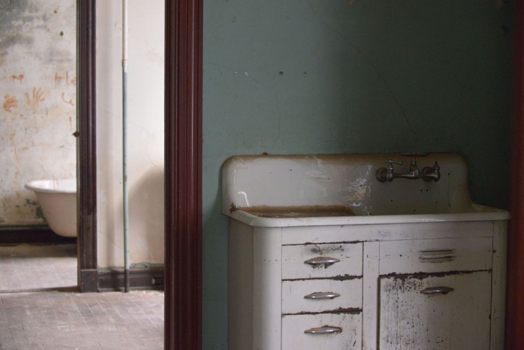 The Immigration Museum currently occupies just two rooms of the former boarding house. The Fessendens hope to eventually restore the rest of the house, turning the upstairs rooms into re-creations of what apartments would have looked like for the city's various immigrant groups. (Christina Tkacik/Baltimore Sun)