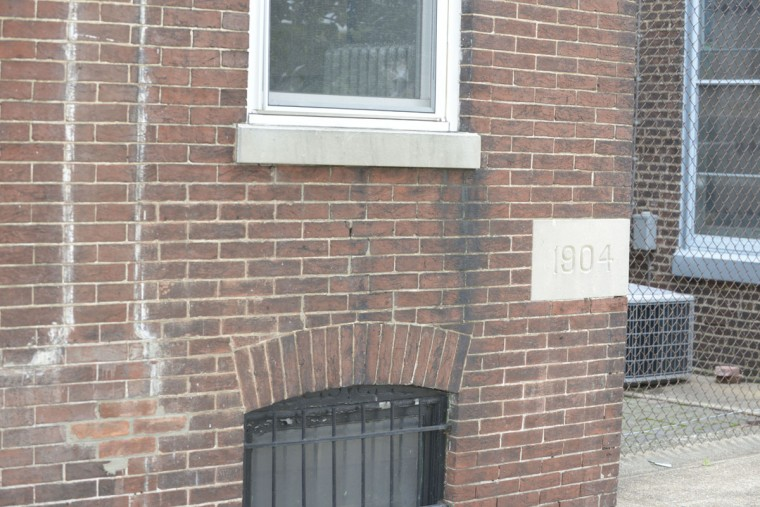 The cornerstone of the German Immigrant House, now the Immigrant Museum, in Locust Point. (Christina Tkacik/Baltimore Sun)