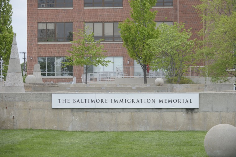 Brigitte and Nicholas Fessenden helped construct the Baltimore Immigration Memorial, which now resides on the Under Armour campus. Earlier plans to build a full-scale Immigration Museum on this site fell through just before Under Armour's acquisition of the land here. (Christina Tkacik/Baltimore Sun)
