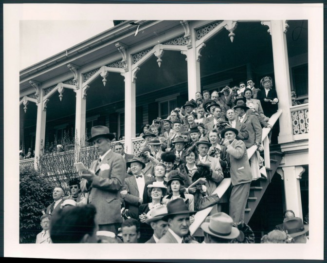 """""""The clubhouse had this veranda porch that was great for people watching,"""" Kelly says. """"And they put on a great show because in 1966 and to a certain degree today, people really dressed to go to the racetrack."""" The best seats in the house were tables along the porch."""