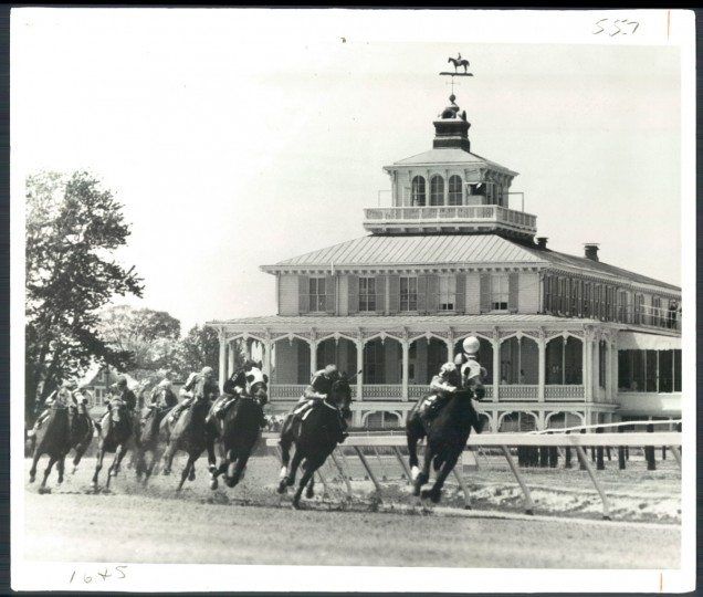 For all the people watching, Kelly says, the horses were always the stars of the show. Here, spectators are seen in the background watching the races from the old clubhouse.