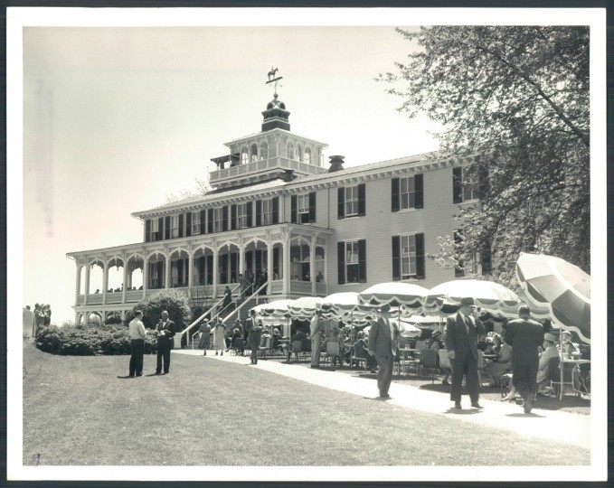 The outside of the clubhouse became a great spot for watching the races, with tables and canvas umbrellas set up on the lawn.