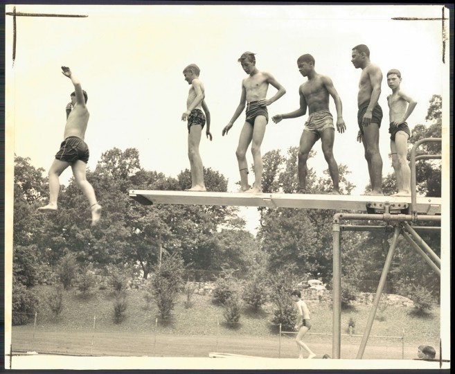 """The newly-integrated Druid Hill Park Springs Swimming Pool, June 23, 1956. (Robinson/Baltimore Sun) The caption for this photo read: """"FOLLOW THE LEADER INTO THE DRINK -- Not all of the divers are executed with Olympic skill at Druid Hill Park, but who cares? The five pools are now open to members of all races."""""""