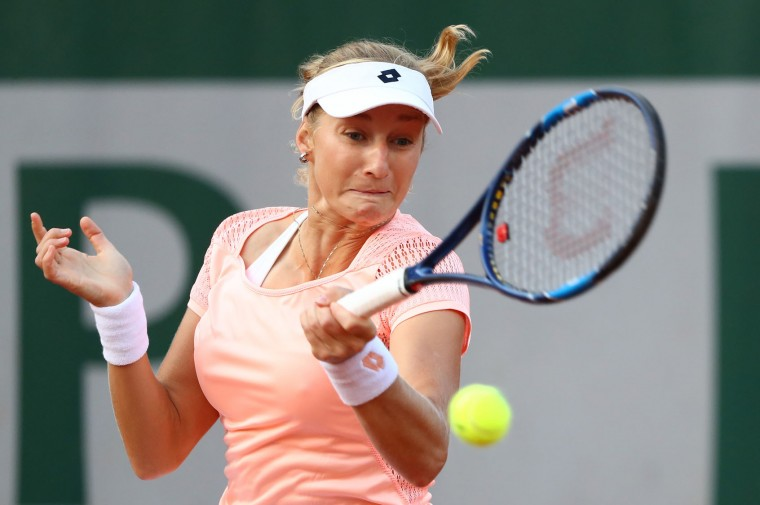 Ekaterina Makarova of Russia plays a forehand during the Women's Singles first round match against Varvara Lepchenko of the United States on day two of the 2016 French Open at Roland Garros on May 23, 2016 in Paris, France. (Photo by Julian Finney/Getty Images)