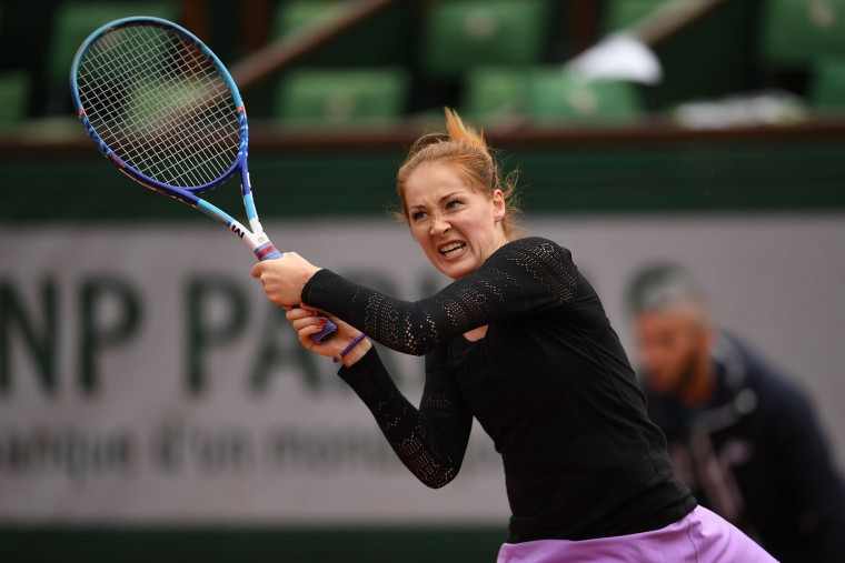Bojana Jovanovski of Serbia plays a backhand during the Women's Singles first round match against Agnieszka Radwanska of Poland on day two of the 2016 French Open at Roland Garros on May 23, 2016 in Paris, France. (Photo by Dennis Grombkowski/Getty Images)