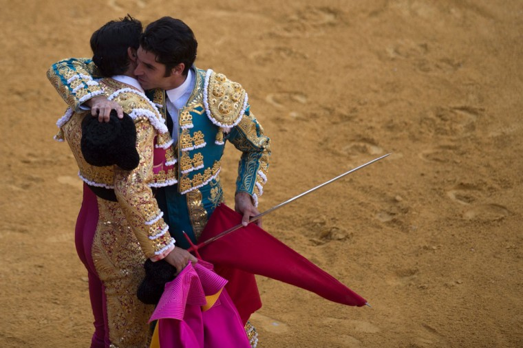 Spanish matador Cayetano Rivera hugs his brother Spanish matador Francisco Rivera Ordonez during the Corpus bullfight festival at the bullring of Granada on May 25, 2016. (JORGE GUERRERO/AFP/Getty Images)