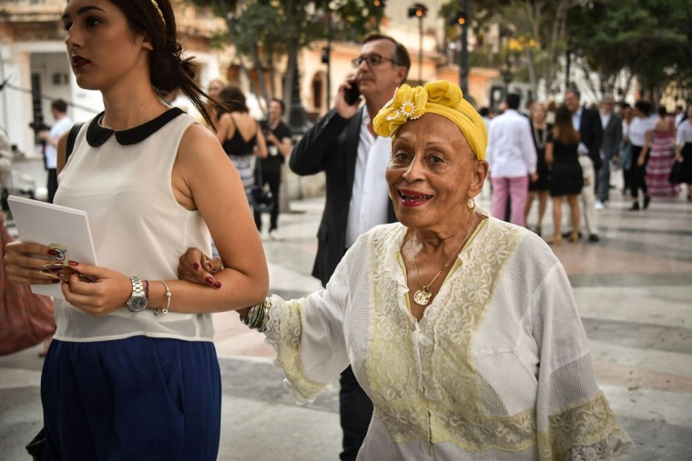 Cuban star singer of the Buena Vista Social Club music band, Omara Portuondo (R) arrives at the Prado promenade in Havana, on May 3, 2016 to watch the Chanel performance. / AFP PHOTO / ADALBERTO ROQUEADALBERTO ROQUE/AFP/Getty Images