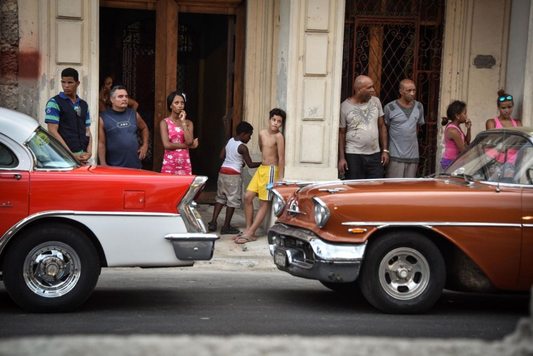 From their houses Cubans try to watch the Chanel performance at the Prado promenade in Havana, on May 3, 2016. / AFP PHOTO / ADALBERTO ROQUEADALBERTO ROQUE/AFP/Getty Images
