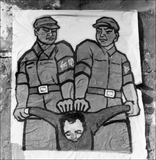 "This file photo taken late in 1966 shows a poster displayed in Beijing featuring how to deal with a so-called ""enemy of the people"" during the ""Great Proletarian Cultural Revolution"". Launched by Mao in 1966 to topple his political enemies after the failure of the Great Leap Forward, the Cultural Revolution saw a decade of violence and destruction nationwide as party-led class conflict devolved into social chaos. (AFP PHOTO / JEAN VINCENT)"