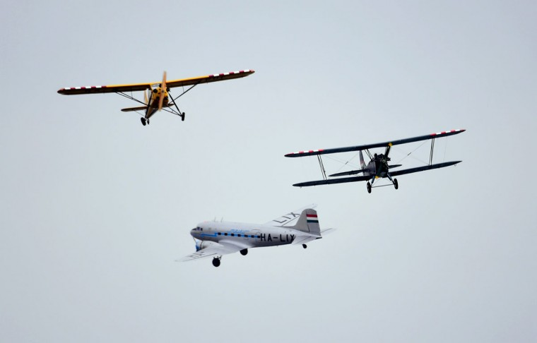 Hungarian pilots present their exercise with a R-180 (left), PO2 (right) and a Russian made Li-2 (center) air planes, over the Danube River in Budapest on May 1, 2016 during the Budapest Air Show. (ATTILA KISBENEDEK/AFP/Getty Images)