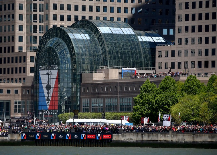 Fans watch near the finish line during Day 2 of the Louis Vuitton America's Cup World Series Racing on May 8, 2016 on the Hudson River in New York City. Teams from six nations are competing for points that go toward the America's Cup final in Bermuda in 2017. (Photo by Elsa/Getty Images)