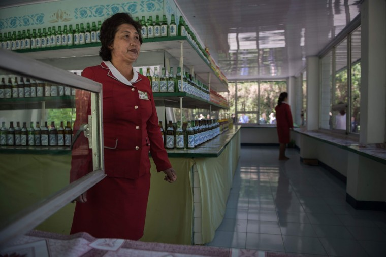 A snack vewndor waits for customers during a media tour of the birthplace of late founder of North Korea Kim Il-Sung, known as 'Mangyongdae', near Pyongyang on May 7, 2016. North Korea's first ruling party congress since 1980 moved into a second day, after leader Kim Jong-Un opened with a defiant defence of his nuclear weapons programme and amid fresh signs Pyongyang is readying a fifth nuclear test. (AFP PHOTO / Ed Jones)