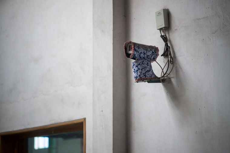 A security camera is seen covered in a floral drape during a media tour of the March 26 Electric Cable Factory in Pyongyang on May 6, 2016. When one of the world's most secretive states opens the door to the international media, it keeps a firm grip on the handle. Some 130 journalists flocked to North Korea at the express invitation of the Pyongyang authorities to cover the opening of a rare ruling party congress. They got within 200 meters of the venue, the April 25 Palace, and that was where they were stopped -- on the other side of the road, under a steady drizzle that had been falling on the capital all morning. Instead of a rare glimpse of the country's highest-level political meeting for almost four decades, the media were then offered a tour of the March 26 Electric Cable Factory. North Korea issues reporting visas sparingly and escorts all journalists to make sure it sets the agenda and gets its point across. (AFP PHOTO / Ed JonesED JONES/AFP/Getty Images)